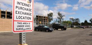 internet purchase exchange location pictured in the parking lot