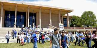 people protest union rights in front of the oviatt library