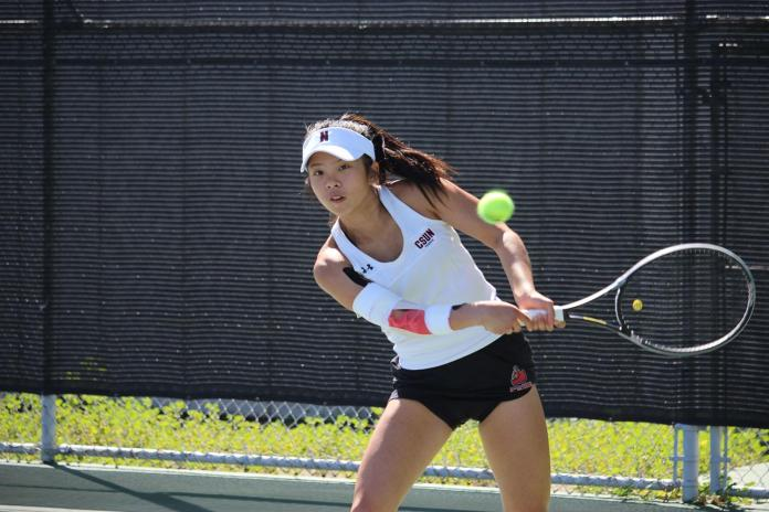 mickey hsu prepares to hit the ball back