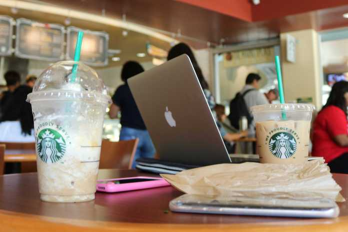 starbucks drinks pictured on the tables at the freudian sip