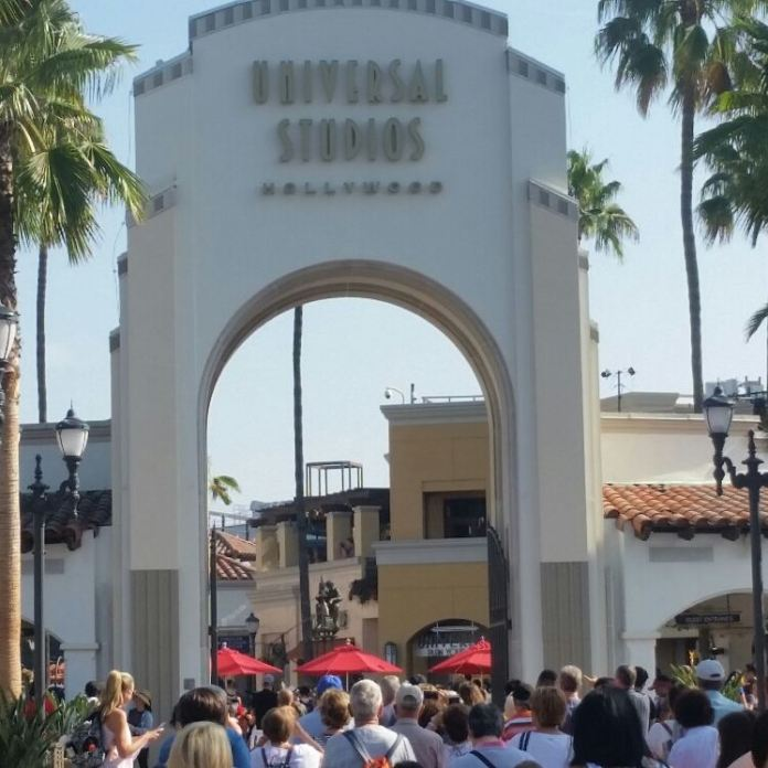 universal studios entrance pictured crowded with people