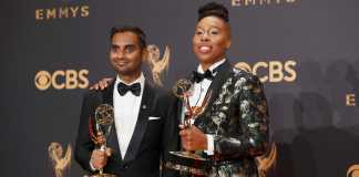 Man and woman pictured next to eachother holding their emmy awards