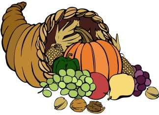 Thanksgiving harvest basket with assorted fruits and vegetables