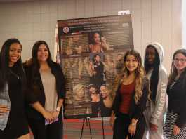 4 woman pose around poster