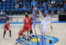 CSUN mens volley ball team in red hits ball into opponents side