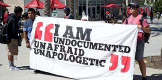 protestors hold I am Undocumented Unafraid Unapologetic banner