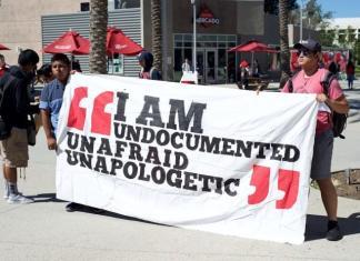 protestors hold I am Undocumented Unafraid Unapologetic banner