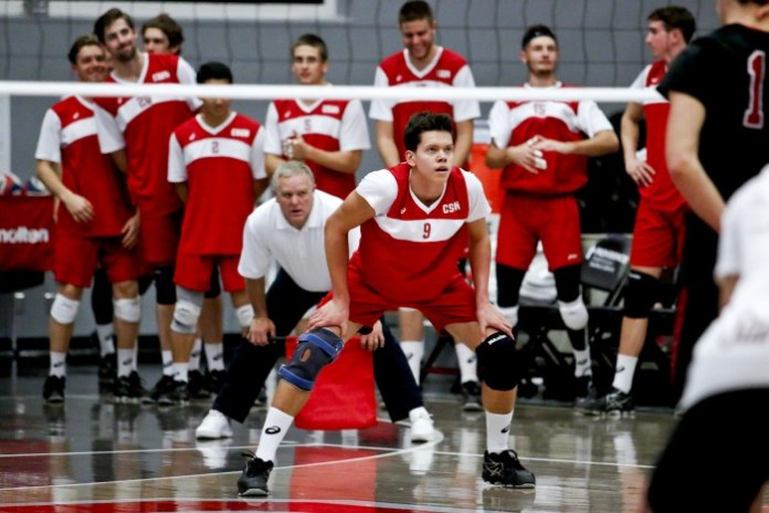 CSUN mens volleyball player holds focused position on the court