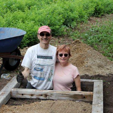 Wally & Linda Eliuk preparing new churchyard toilet (06-Jul-2013)