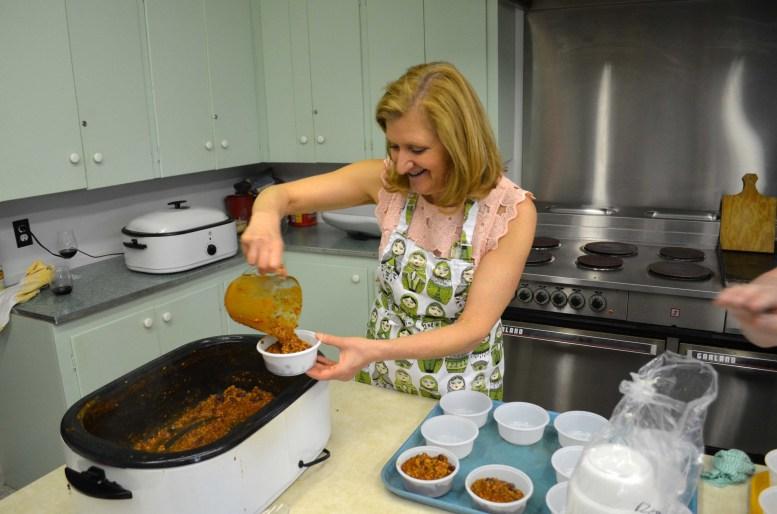 Bonnie Eliuk serving chili