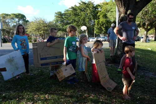 A line forms for cardboard sledding.