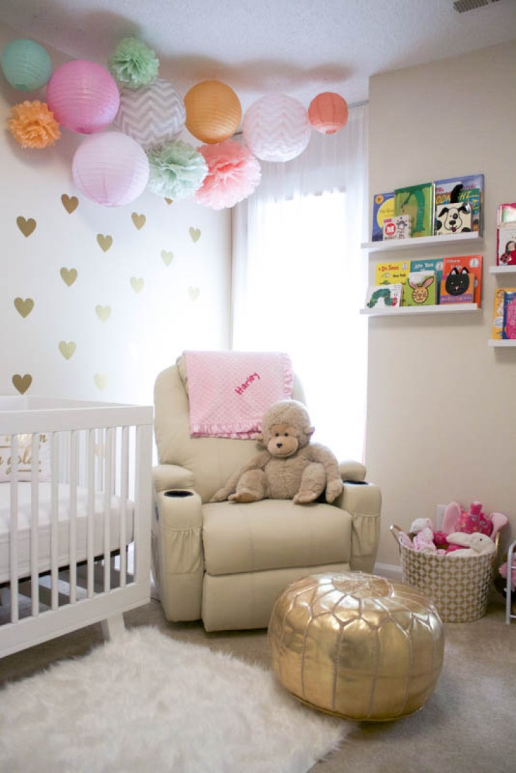 baby girl nursery with paper lantern decor