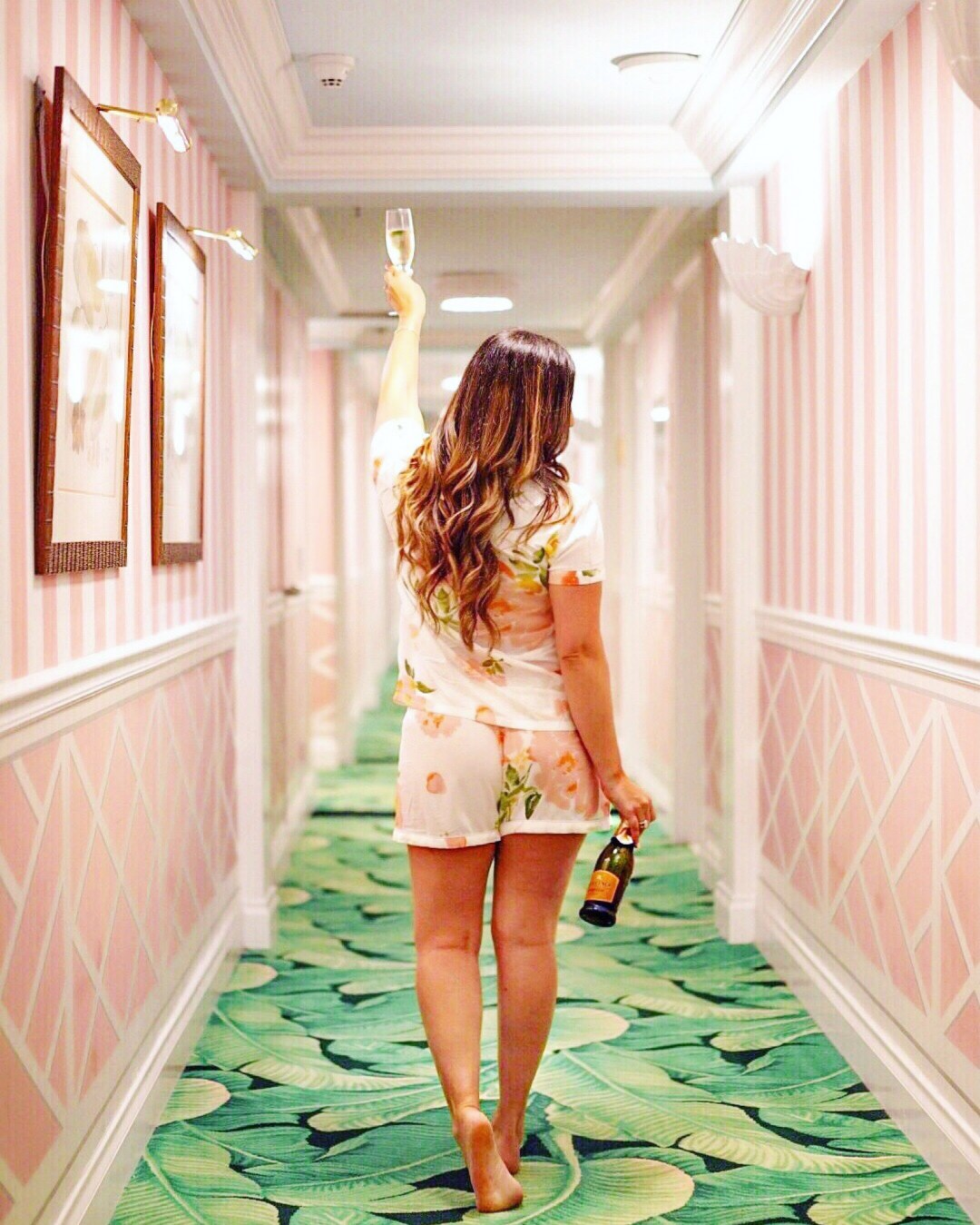 Colony Palm Beach hotel pink hallway - Jaime Cittadino - travel blogger