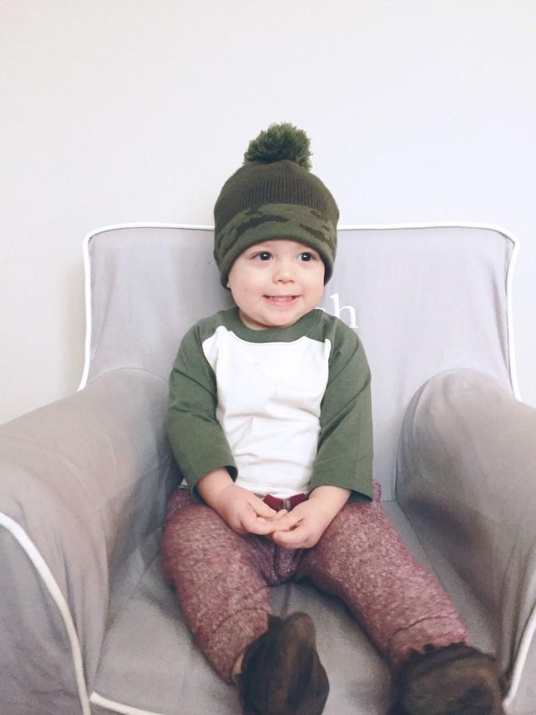 Nash in a camo pom pom hat