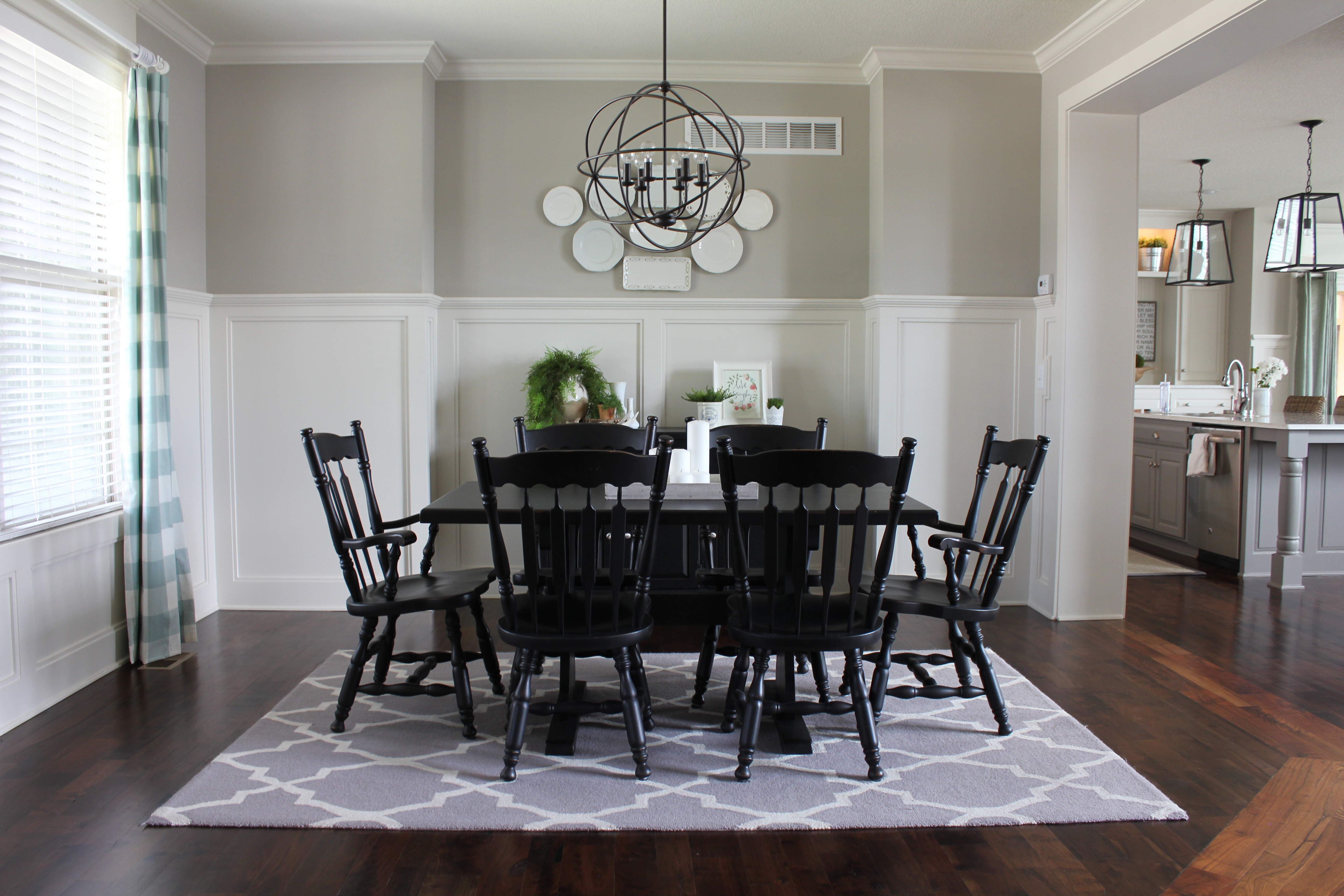 dining room with plate wall
