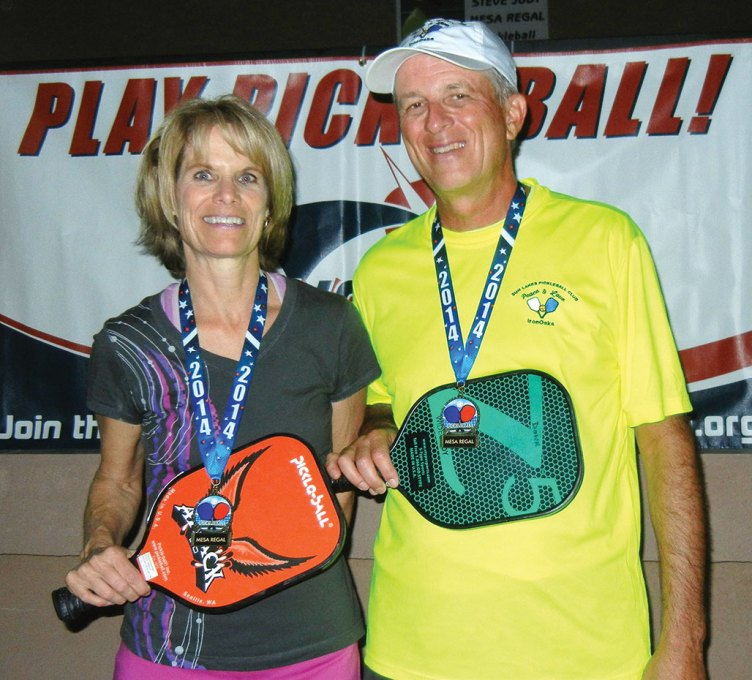 Atop the podium are gold medal winners Dianne Zimmerman and David Zapatka