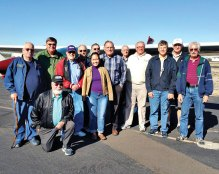 Sun Lakes Aero Club members and guests making the trip to Marana are pictured in front of Bill Brown's Cessna 182: Standing (l-r) Earl Cuyler, Hank Bielema, Gary Vacin, Gene Evans, Jessica Cox, Dick Simmons, Roger Bartels, Bob DeLong, Bill Brown, Steve Perkins, Gary West and J.R. Schiedereiter; kneeling Louis Cuyler