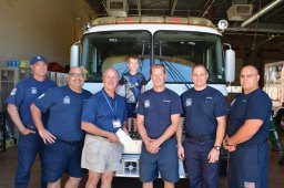 The SLFD crew pictured (left to right) Firefighter/Paramedic Tom Geffert, Paramedic Jaime Gonzales, Jerry Rex and his grandson Brendan, Engineer/Paramedic David DeGraaf, Firefighter/EMT Tyler Quier and Captain/EMT Ron Puchta.