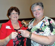 Regent Barbara Hugus (left) passes the gavel to Lesley Baran.