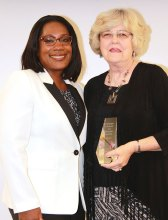 Pictured left to right are Sheena Oliver, Vice President of Marketing for Oticon, Inc. and Elizabeth Booth, Advocacy Category winner.