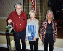 The door prize winners from the December dance are from left to right: Rob Calhoun, Nancy Roger and Andrea Daily.