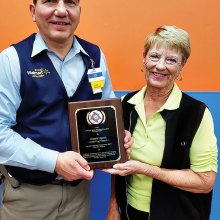 Joe Liguori, Manager, Walmart Superstore 2671 in Chandler, being presented with a plaque of appreciation by Betty Peer, Chairman, Veterans and Family Services, Sun Lakes VFW Post 8053 Auxiliary