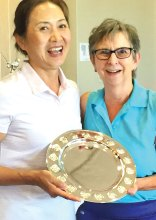 E.J. Toon receives her Club Championship prize from club President Betty Schechter