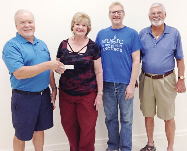 CWPV Foundation Vice President Richard Hawkes presents a grant to Sandy Bocynesky, Executive Director of the Chordaires. Chordaires Musical Director Marc Gaston and CWPV Foundation Director Bob Rouleau also participated in the event.