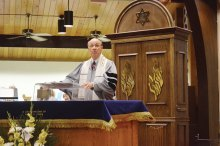 Rabbi Irwin Wiener leading services