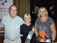 Door prize winners at the Oct. 24 Dinner/Dance (left to right): Bob Roller, Carolyn Guaerra, and Colleen Linko