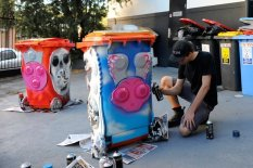 Youth paint a bin that Camden Council purchased