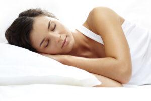 Woman lying on side sleeping peacefully.