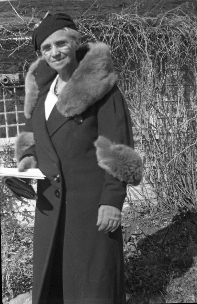 FYC, dressed in fur trimmed winter coat, hat, gloves