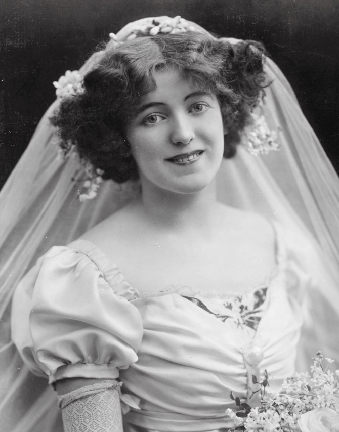 The bride has a bob. Some time before 1914, according to the site. Getty image.