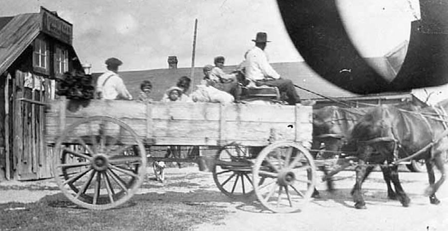 Horse-drawn wagon.