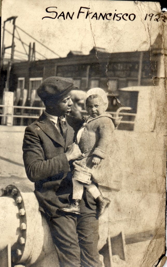 1922. Charlie Reid with Bertha, SF waterfront. He worked as a longshoreman at that time. Courtesy Charles Reid/Ivy Reid Collection.