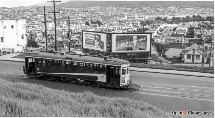 1942. Monterey Blvd at Detroit. Entrance ot Lower Detroit Steps clearly visible in this shot on far left. Apartment building now stands on site of double billboard. OpenSFHistory.org