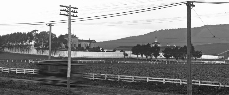 1905. View of Ingleside Jail from Ocean Avenue, looking northwest. Southern Pacific tracks run just below jail's white fence. Courtesy SFMTA. Cropped from U00341. sfmta.photoshelter.com