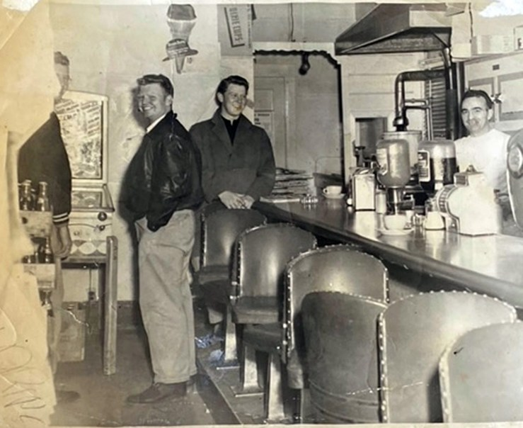 Interior, Bruno's Creamery, about 1955. Bruno Cappa on far right, with unidentified customers. Photo courtesy Marilyn Cappa Kennedy.