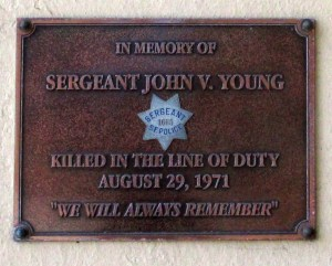 The plaque mounted outside the Ingleside Police Station in honor of Sgt John V Young.