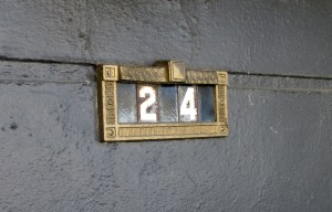 A Slimline style unit on Coventry Court, rehabbed with gold paint. This street was once all Fazekas units, installed by builder. Note full-sized spacer tile between digits.