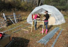 Kelsey and Rae cutting the dome pipe.