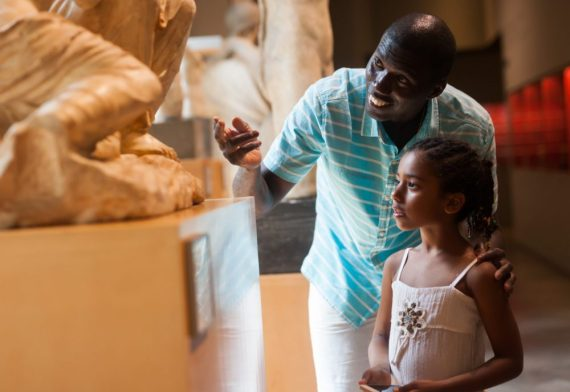 African,American,Man,And,His,Little,Daughter,Looking,At,Exhibits