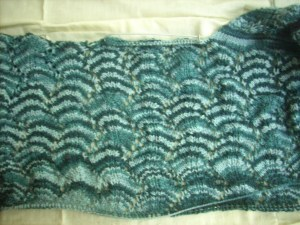 The back panel with the neck stitches on holder