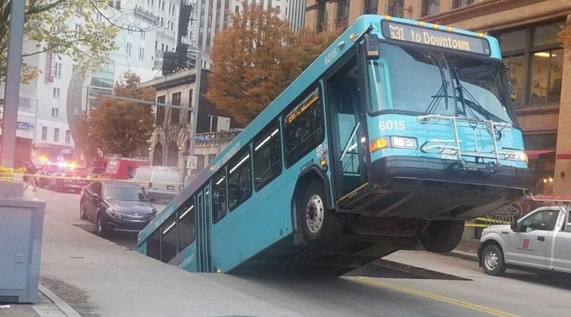 Port authority bus falls backward into sinkhole in Pittsburgh, USA