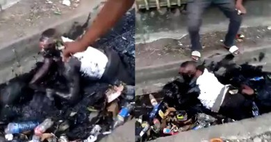 Bus conductor, passenger fight and fall inside dirty gutter over N100