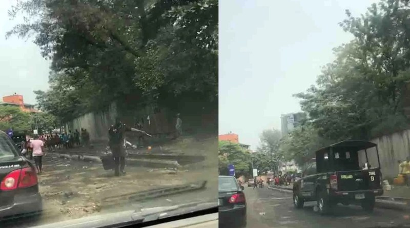 Police officers join to scoop fuel as tanker falls in Lagos