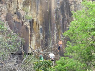 Three abseiling on the cliff