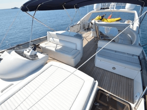 """The flybridge of the 75 Yacht """"SOMETHING DIFFERENT"""" houses a jet ski, in addition to providing comfortable exterior areas, secondary helm and full wet bar"""