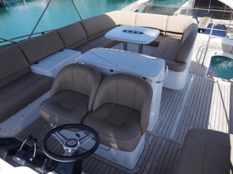 The Princess 58 offers an expansive flybridge area, including secondary helm, wetbar and seating areas